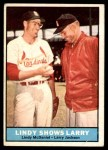 1961 Topps #75   -   Larry Jackson / Lindy McDaniel Lindy Shows Larry  Front Thumbnail