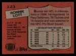 1987 Topps #123  Ronnie Lott  Back Thumbnail